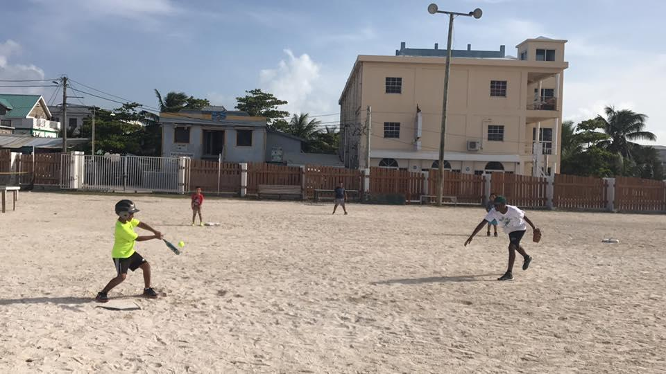 A Projects Abroad volunteer coaching sports in schools in Belize encourages players